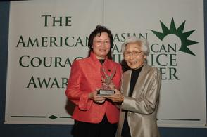 Dr. Leslie Moe Kaiser presents Susan Ahn Cuddy with the 2006 Asian American Justice Center American Courage Award at the National Press Club in Washington, D.C.